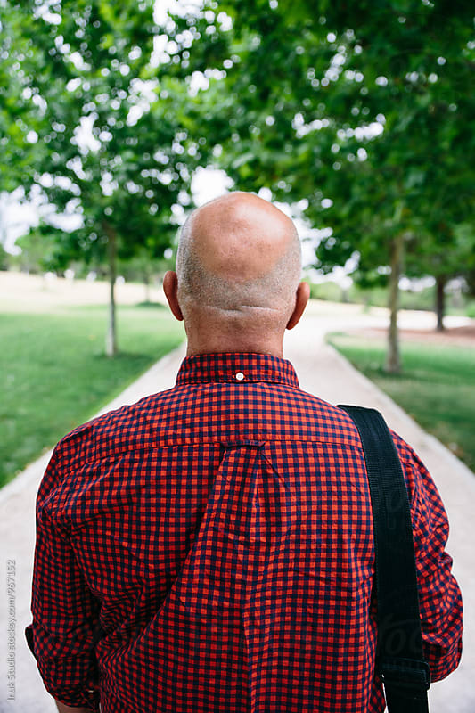 Back view of bald senior man by Inuk Studio for Stocksy United