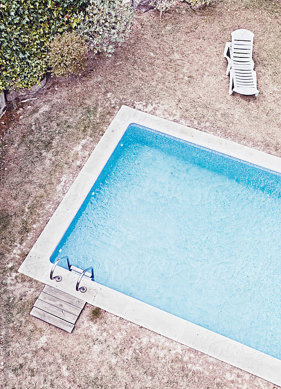 Derelict hotel pool by Photographer Christian B for Stocksy United