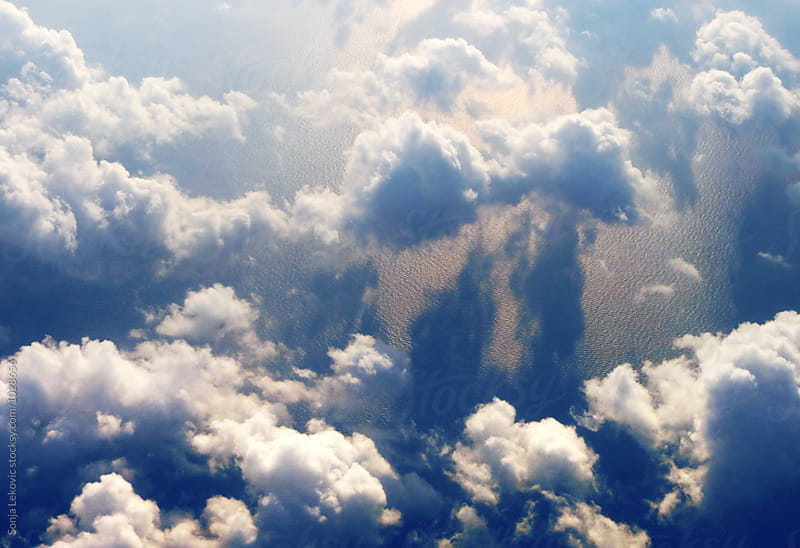 clouds above the sea by Sonja Lekovic for Stocksy United