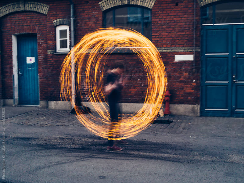 Fire juggling by Photographer Christian B for Stocksy United