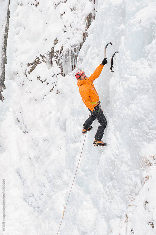 Ice climber on a frozen waterfall by RG&B Images for Stocksy United