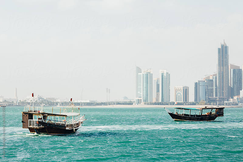 Old boats in Doha by Maja Topcagic for Stocksy United