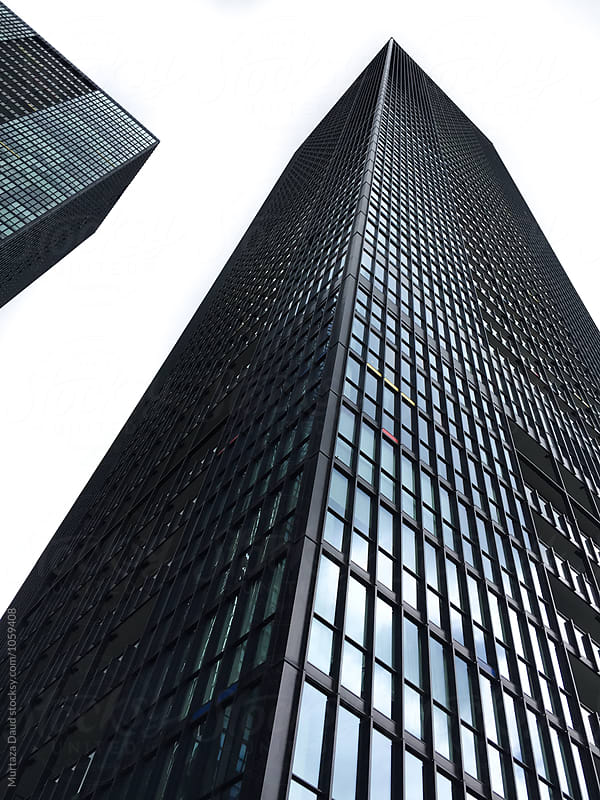 A high black building in Downtown Toronto Canada by Murtaza Daud for Stocksy United