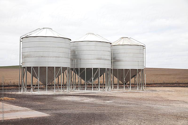 Grain silos on roadside in the Australian country by Natalie JEFFCOTT for Stocksy United