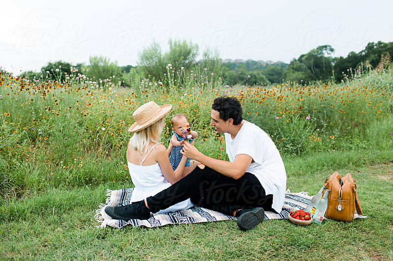 Young family by Kayla Snell for Stocksy United