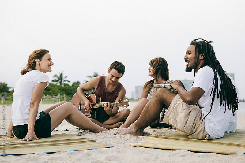 Friends Making Music at the Beach by Stephen Morris for Stocksy United