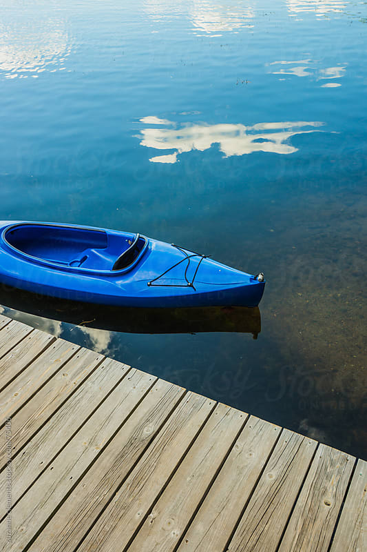 Blue Kayak on Still Waters by suzanne clements for Stocksy United