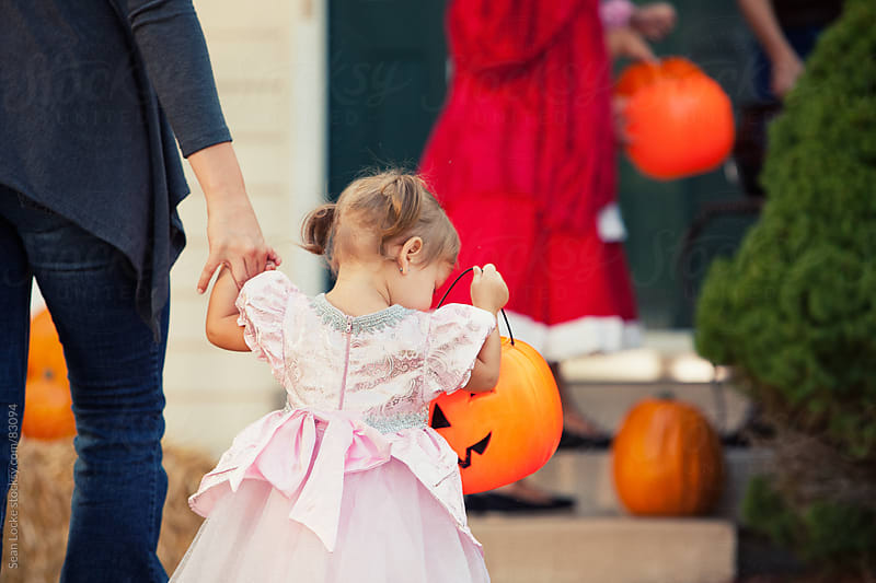 Halloween: Little Girl Trick-Or-Treating by Sean Locke for Stocksy United