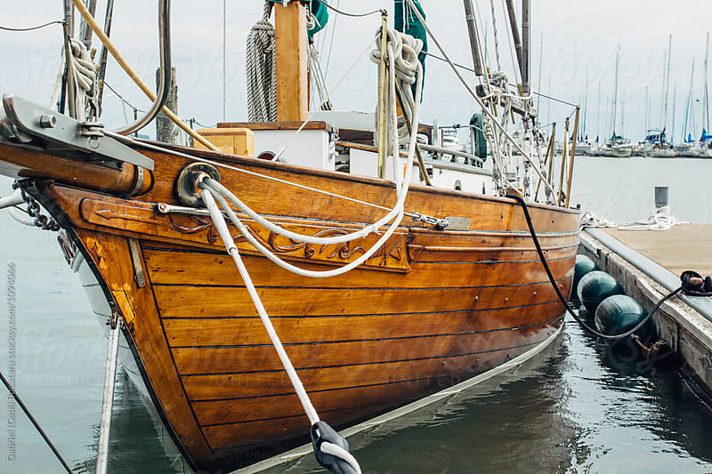 Old wooden boat docked by Gabriel (Gabi) Bucataru for Stocksy United