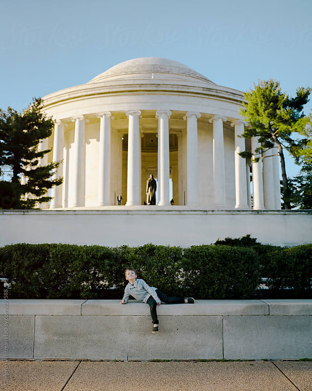 Young boy posing hilariously in front of the Jefferson Memorial by Cameron Whitman for Stocksy United
