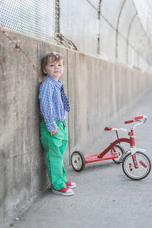 Dapper Toddler Boy With His Tricycle by Cameron Whitman for Stocksy United