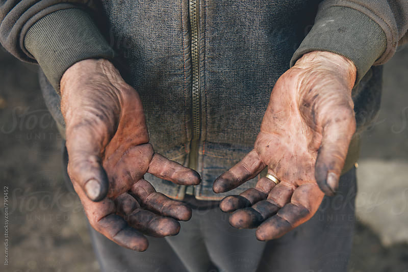 Worker showing his dirty hands by RG&B Images for Stocksy United