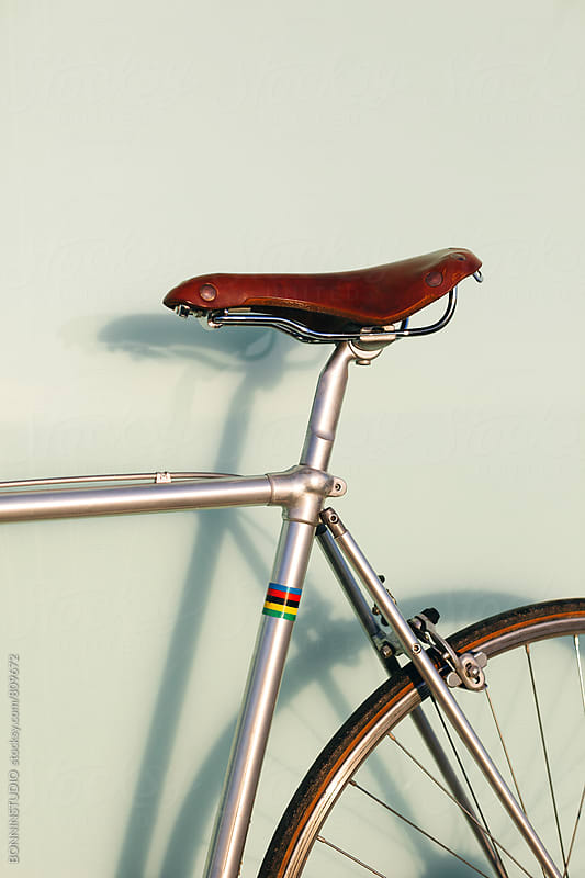 Closeup of a leather saddle of a vintage bicycle. by BONNINSTUDIO for Stocksy United