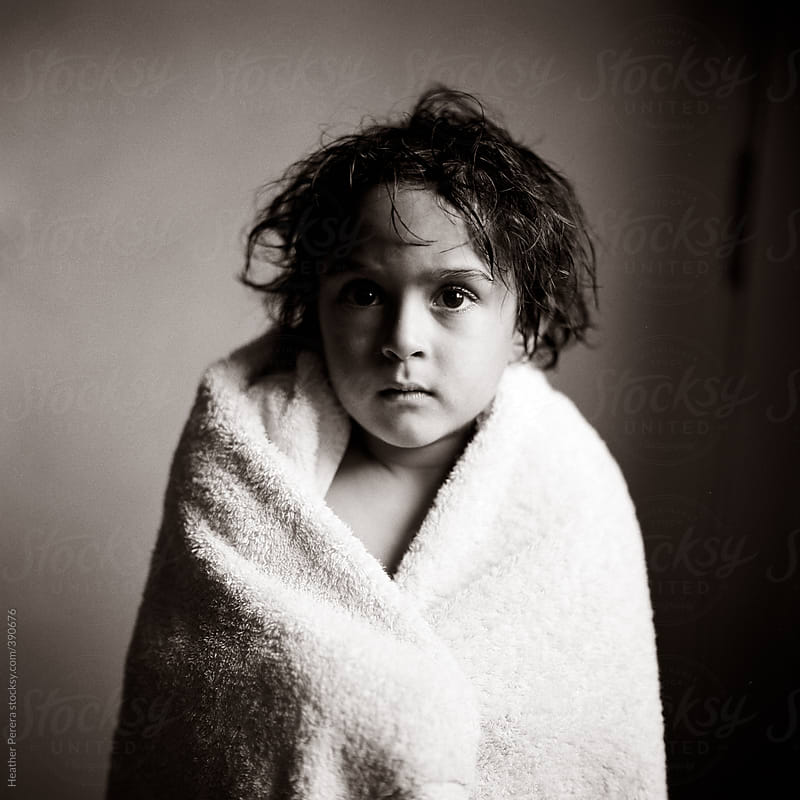 boy in towel after bath by Heather Perera for Stocksy United