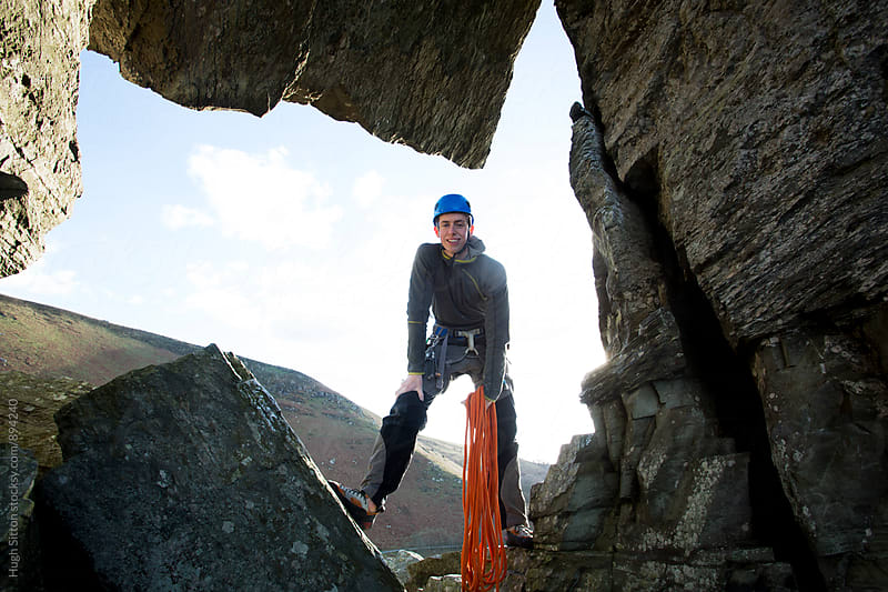 Teenage boy, rock climbing. by Hugh Sitton for Stocksy United