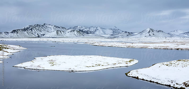 Small snow covered islands in a lake by Jonatan Hedberg for Stocksy United