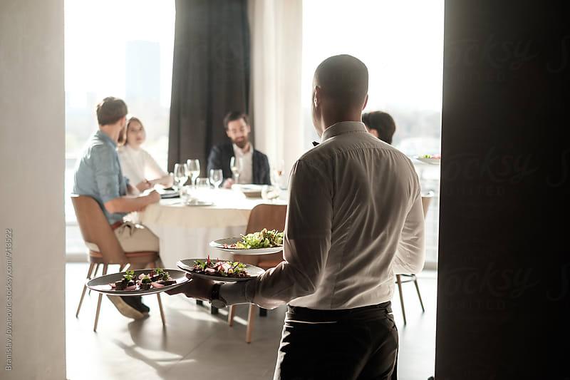 Waiter Serving Food at the Restaurant by Branislav Jovanovic for Stocksy United