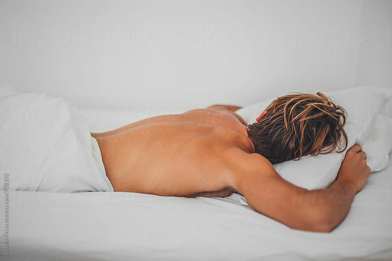 Young Man sleeping. by Studio Firma for Stocksy United