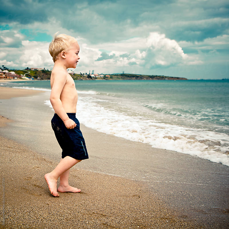 Boy Playing at the Beach by Stephen Morris for Stocksy United