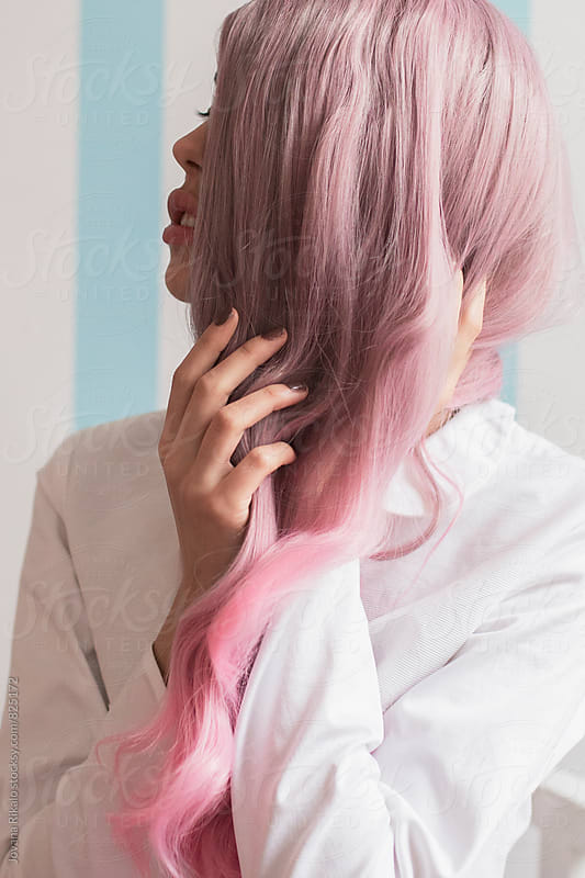 Fashionable young woman with pink hair portrait by Jovana Rikalo for Stocksy United