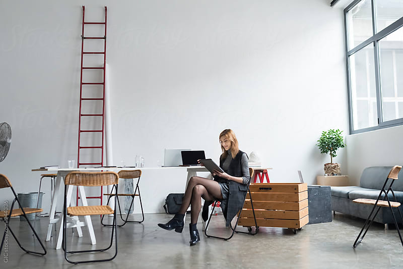 Businesswoman in a modern workspace by GIC for Stocksy United