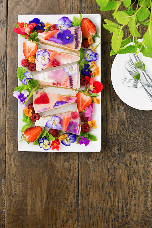 Jelly dessert slice wedges with edible flowers with copy space by Kirsty Begg for Stocksy United