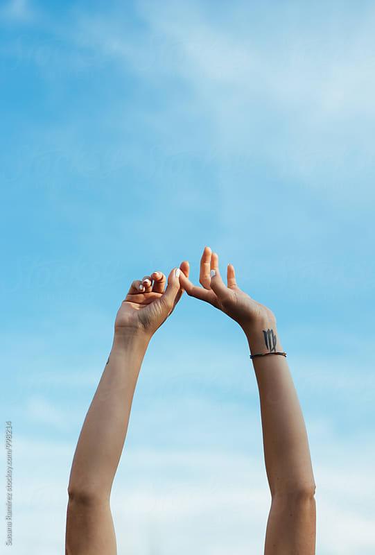 Arms woman raised to sky by Susana Ramírez for Stocksy United