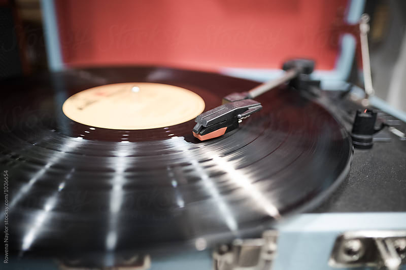 VIntage portable record player playing the last trackof an album by Rowena Naylor for Stocksy United