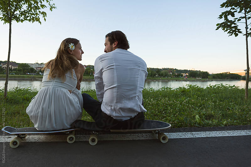 Modern couple relaxing in the park by RG&B Images for Stocksy United