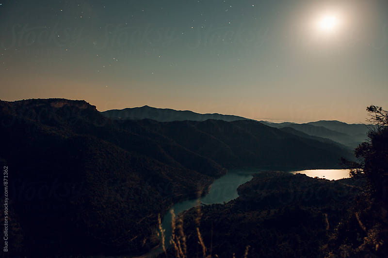 Full moon in Siurana lake  by Jordi Rulló for Stocksy United