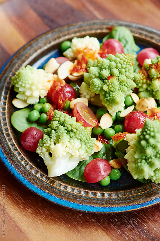 Romanesco and Peas by Harald Walker for Stocksy United