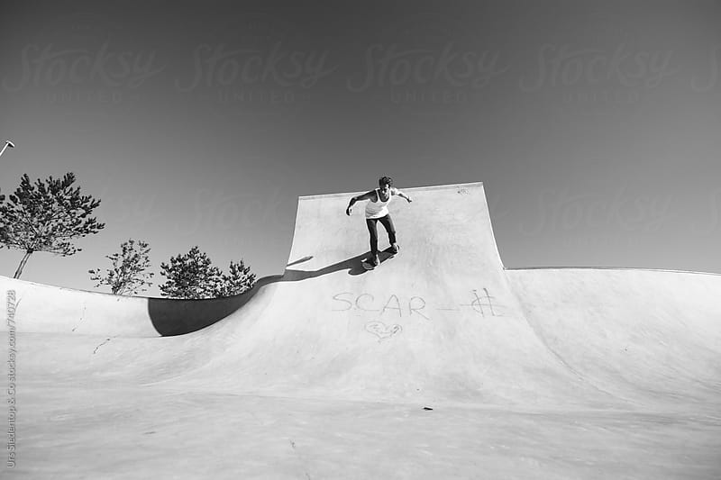 Skater in skate pool by Urs Siedentop & Co for Stocksy United
