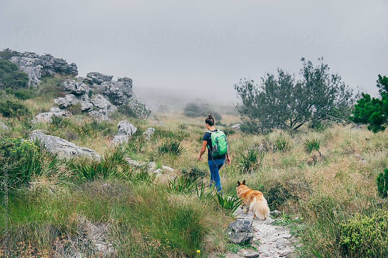 Hiker walking on an outdoor trail in the mountains by Micky Wiswedel for Stocksy United