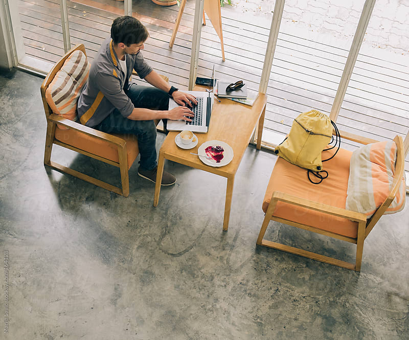 Young Entrepreneur Working from a Modern Coffee Shop by Marija Savic for Stocksy United