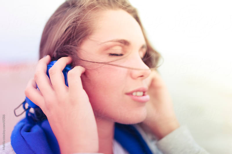 Young Woman Listening Music With Headphones by HEX. for Stocksy United