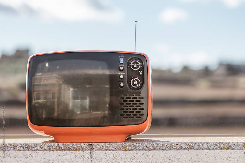 Vintage television with a sky background by Javier Pardina for Stocksy United