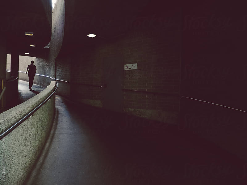 Silhouette of a Man in an Underground Walkway by Gary Radler Photography for Stocksy United