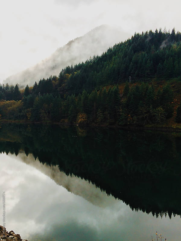 Mountains Reflected onto Water on Beautiful Foggy Day by B. Harvey for Stocksy United