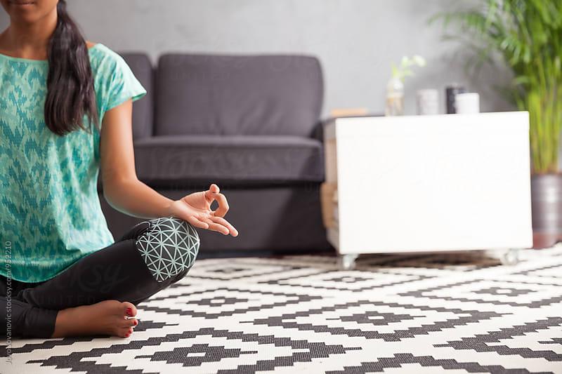 Woman meditating at home by Jovo Jovanovic for Stocksy United