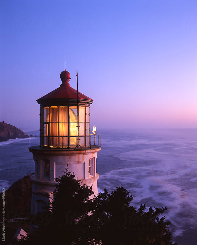 Heceta Head lighthouse at sunset by Mark Windom for Stocksy United