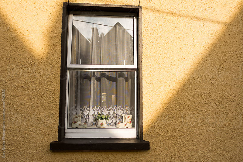 Reflection of another house in a window by Gary Radler Photography for Stocksy United