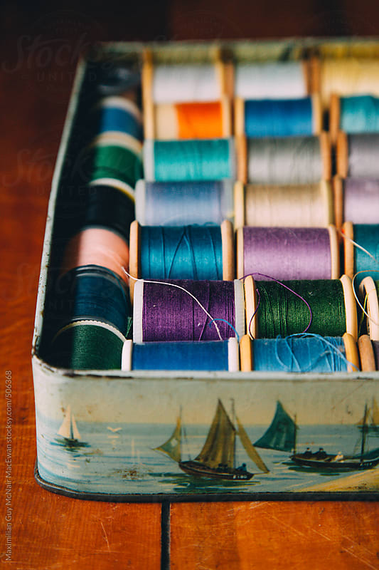 A collection of sewing threads by Maximilian Guy McNair MacEwan for Stocksy United