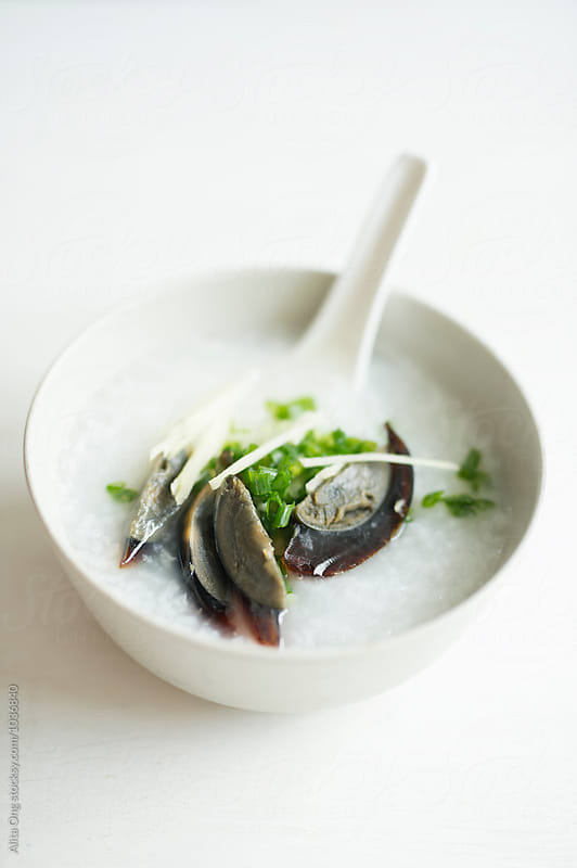 Century egg congee by Alita Ong for Stocksy United