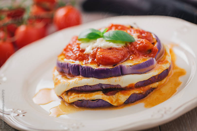 Eggplants Parmigiana by Davide Illini for Stocksy United