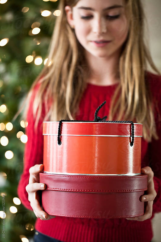 Girl with Red Christmas Gift Boxes by Jill Chen for Stocksy United