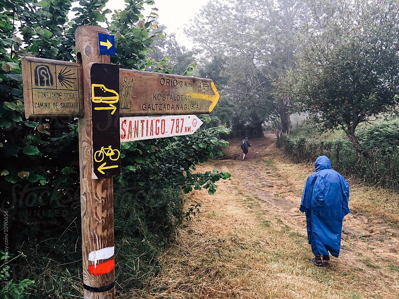 Pilgrim under the rain walking the Camino de Santiago by Luca Pierro for Stocksy United