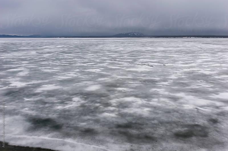 Frozen Yellowstone Lake by Adam Nixon for Stocksy United