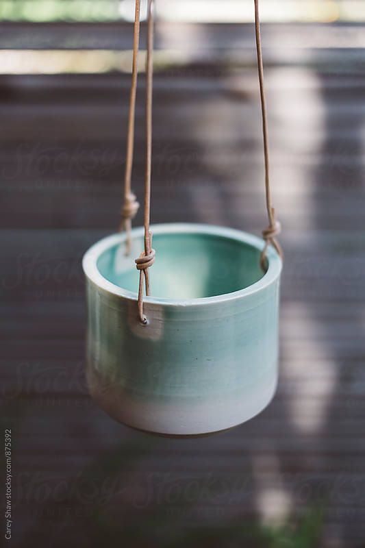 Hanging handmade ceramic planter by Carey Shaw for Stocksy United