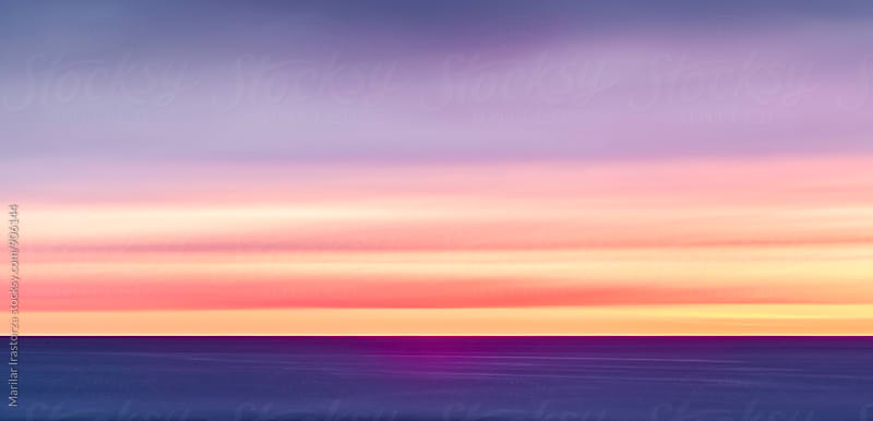 Colorful view of midnight sun over the sea by Marilar Irastorza for Stocksy United
