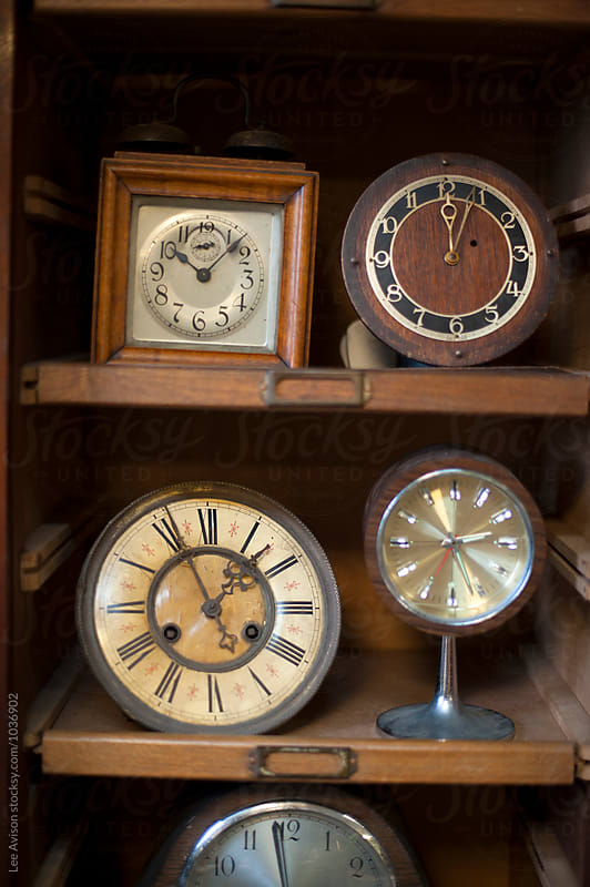 vintage clocks by Lee Avison for Stocksy United